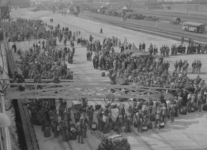 US Army soldiers boarding troop transport during WWII
