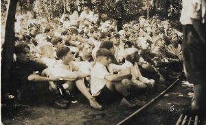 Boys at camp Takodah in 1936 presumably listening to a story from Uncle Oscar Elwell. Allen is possibly present in this photograph.